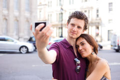 Couple taking a selfie Royalty Free Stock Image