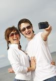 Couple taking a selfshoot picture royalty free stock photography