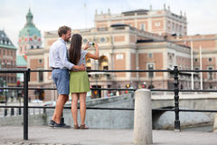 Couple taking smartphone photos in Stockholm city Royalty Free Stock Images