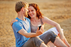 Couple taking smartphone selfie at beach Royalty Free Stock Image