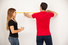 Couple taking some measurements Royalty Free Stock Images