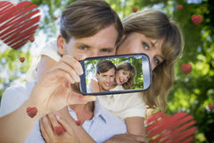 Couple taking Valentines selfie. Composite of Couple taking Valentines selfie Stock Photography