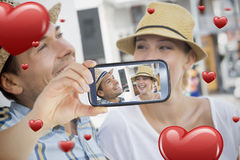 Couple taking Valentines selfie. Composite of Couple taking Valentines selfie Royalty Free Stock Photo