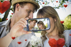 Couple taking Valentines selfie. Composite of Couple taking Valentines selfie Stock Image