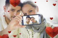 Couple taking Valentines selfie. Composite of Couple taking Valentines selfie Stock Photos