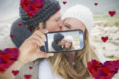 Couple taking Valentines selfie. Composite of Couple taking Valentines selfie Royalty Free Stock Photos