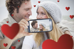 Couple taking Valentines selfie. Composite of Couple taking Valentines selfie Royalty Free Stock Images