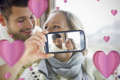 Couple taking Valentines selfie. Composite of Couple taking Valentines selfie Stock Photo