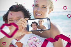 Couple taking Valentines selfie. Composite of Couple taking Valentines selfie Stock Images