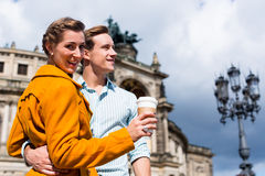 Couple taking walk at Semperoper in Dresden Stock Images