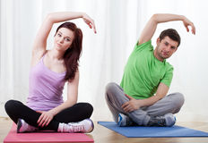 Couple taking yoga classes Royalty Free Stock Photography