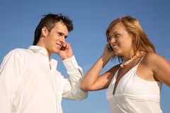 Couple talk on cell phones Royalty Free Stock Images