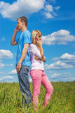 Couple talk on cell phones Stock Images