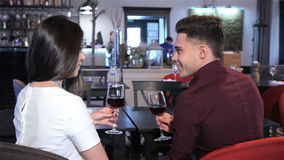 Couple talk at the restaurant stock footage
