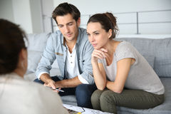 Couple talking with architect about construction plan Royalty Free Stock Image