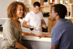 Couple talking in a bar Royalty Free Stock Image