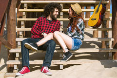 Couple talking on a beach stairs stock image