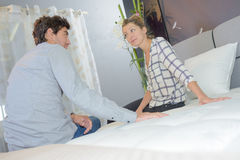 Couple talking on bed. Couple talking on the bed stock images