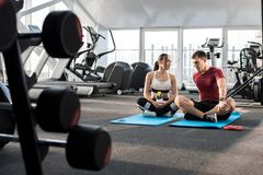 Couple Talking during Break in Gym royalty free stock photo
