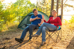 Couple talking on camping holiday. Couple talking on a camping holiday stock image