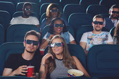 Couple talking in cinema and watching film. stock photo