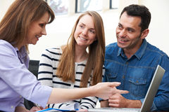 Couple Talking With Female Financial Advisor In Office Stock Image
