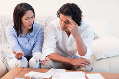 Couple talking about financial problems Royalty Free Stock Photos