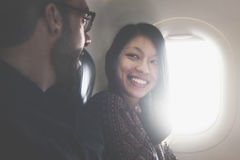 Couple Talking Flying Aeroplane Concept Stock Image