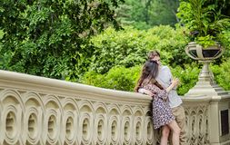 Couple in Central Park New York City. Couple talking and having fun on Bow Bridge in Central park in New York City royalty free stock images