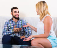 Couple talking at home Royalty Free Stock Image