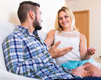 Couple talking at home Stock Photos