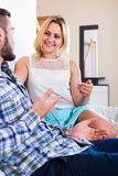 Couple talking at home Stock Images