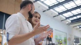 Couple talking in the mall stock footage