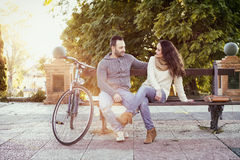 Couple while they are talking in the park. With analog effect royalty free stock images