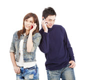 Couple talking on the phone Stock Photos