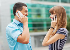 Couple talking on the phone Royalty Free Stock Image