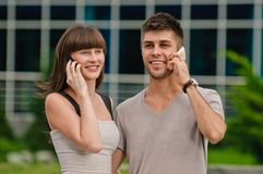 Couple of talking on the phone Royalty Free Stock Images