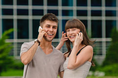 Couple of talking on the phone Stock Images
