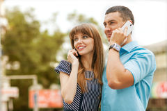 Couple talking on the phone Stock Images