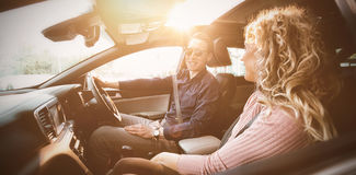 Couple talking while sitting in car. During test drive Royalty Free Stock Photos