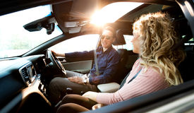 Couple talking while sitting in car royalty free stock image