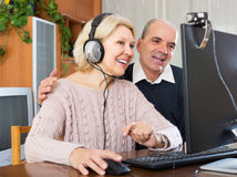 Couple talking with someone online Stock Photography