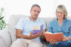 Couple talking about their books Stock Images