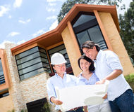 Couple talking to architect about a house Royalty Free Stock Images