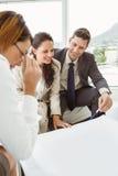 Couple talking to female architect royalty free stock photos