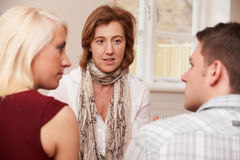Couple Talking To Relationship Counsellor Royalty Free Stock Images
