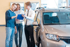Couple talking to sales consultant in showroom Stock Photos