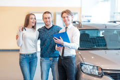 Couple talking to sales consultant in showroom Stock Images