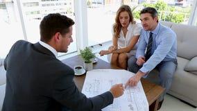 Couple talking to their architect