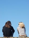 Couple talking under the sky Royalty Free Stock Photos